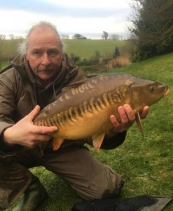 Andrew with mirror carp 1